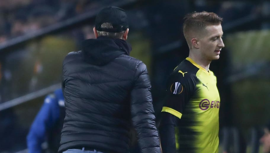 DORTMUND, GERMANY - FEBRUARY 15: Marco Reus of Dortmund walks past head coach Peter Stoeger after being substituted during UEFA Europa League Round of 32 match between Borussia Dortmund and Atalanta Bergamo at the Signal Iduna Park on February 15, 2018 in Dortmund, Germany.  (Photo by Alex Grimm/Bongarts/Getty Images)