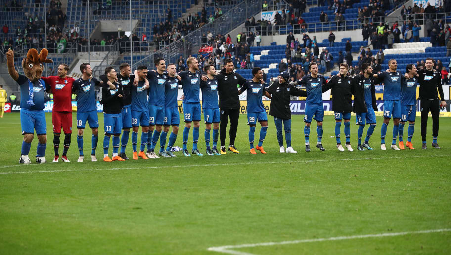 SINSHEIM, GERMANY - MARCH 10: Players of Hoffenheim celebrate in front of their supporters, after the Bundesliga match between TSG 1899 Hoffenheim and VfL Wolfsburg at Wirsol Rhein-Neckar-Arena on March 10, 2018 in Sinsheim, Germany. (Photo by Alex Grimm/Bongarts/Getty Images)