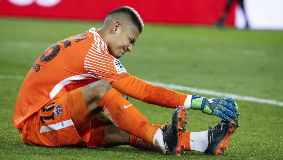 Paris Saint-Germain's French goalkeeper Alphonse Areola suffers from cramp during the French L1 football match between Paris Saint-Germain (PSG) and Marseille (OM) at the Parc des Princes in Paris on February 25, 2018.  / AFP PHOTO / GEOFFROY VAN DER HASSELT        (Photo credit should read GEOFFROY VAN DER HASSELT/AFP/Getty Images)