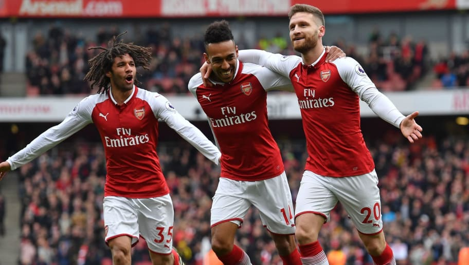Arsenal's German defender Shkodran Mustafi (R) celebrates with Arsenal's Egyptian midfielder Mohamed Elneny (L) and Arsenal's Gabonese striker Pierre-Emerick Aubameyang (C) after scoring the opening goal of the English Premier League football match between Arsenal and Watford at the Emirates Stadium in London on March 11, 2018.  / AFP PHOTO / Ben STANSALL / RESTRICTED TO EDITORIAL USE. No use with unauthorized audio, video, data, fixture lists, club/league logos or 'live' services. Online in-match use limited to 75 images, no video emulation. No use in betting, games or single club/league/player publications.  /         (Photo credit should read BEN STANSALL/AFP/Getty Images)