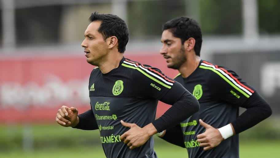 Mexico's goalkeepers Rodolfo Cota and Jesus Corona (R) jog during a training session on October 02, 2017 in Mexico City, ahead of their upcoming 2018 FIFA World Cup qualifier match against Trinidad&Tobago on October 6. / AFP PHOTO / OMAR TORRES        (Photo credit should read OMAR TORRES/AFP/Getty Images)