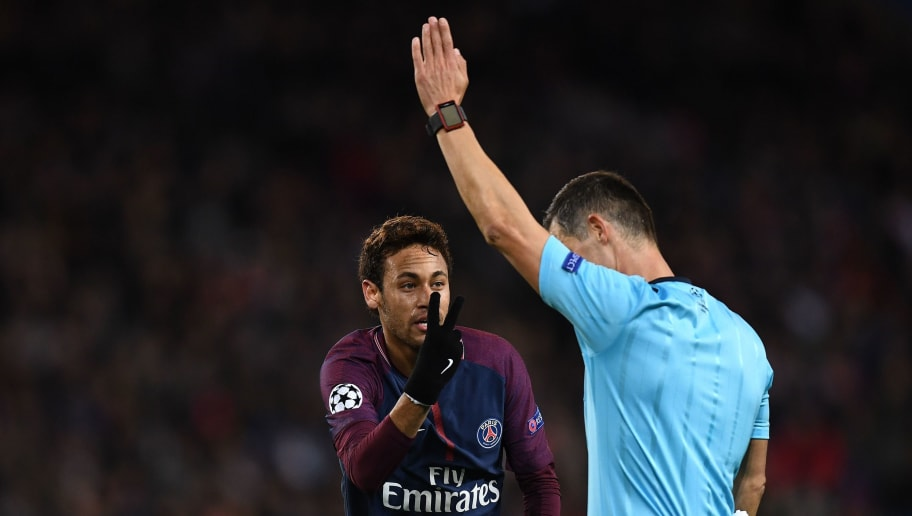 Paris Saint-Germain's Brazilian striker Neymar (C) reacts as Greece's referee Tasos Sidiropoulos gestures during the UEFA Champions League Group B football match between Paris Saint-Germain (PSG) and Glasgow Celtic at Parc des Princes Stadium in Paris on November 22, 2017.  / AFP PHOTO / FRANCK FIFE        (Photo credit should read FRANCK FIFE/AFP/Getty Images)