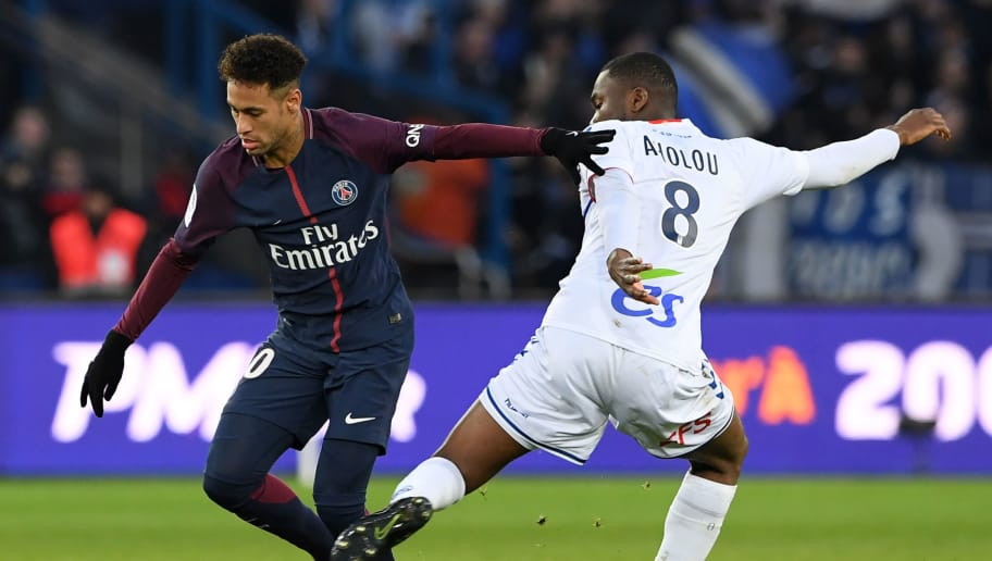 TOPSHOT - Paris Saint-Germain's Brazilian striker Neymar (L) fights for the ball with Strasbourg's Ivorian defender Jean-Eudes Aholou during the French Ligue 1 football match between Paris Saint-Germain (PSG) and Strasbourg at The Parc des Princes in Paris on February 17, 2018.  / AFP PHOTO / CHRISTOPHE ARCHAMBAULT        (Photo credit should read CHRISTOPHE ARCHAMBAULT/AFP/Getty Images)