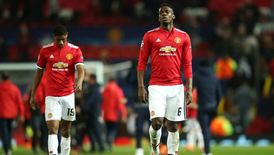 MANCHESTER, ENGLAND - MARCH 13:  Paul Pogba and Marcus Rashford of Manchester United look dejected in defeat after the UEFA Champions League Round of 16 Second Leg match between Manchester United and Sevilla FC at Old Trafford on March 13, 2018 in Manchester, United Kingdom.  (Photo by Clive Mason/Getty Images)