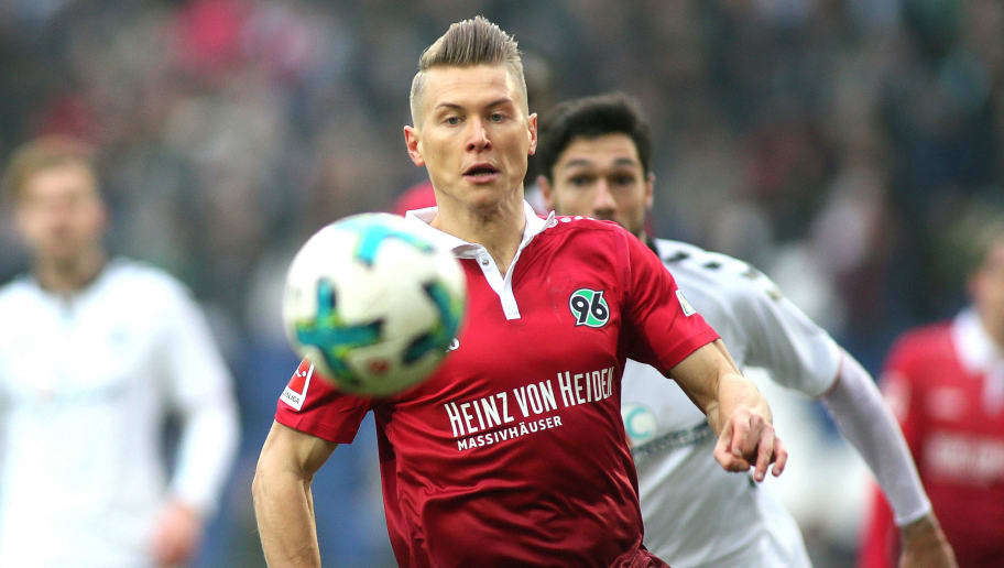 HANOVER, GERMANY - FEBRUARY 10: Matthias Ostrzolek of Hannover 96 (L) fights for the ball with Tim Kleindienst of SC Freiburg during the Bundesliga match between Hannover 96 and Sport-Club Freiburg at HDI-Arena on February 10, 2018 in Hanover, Germany. (Photo by Selim Sudheimer/Bongarts/Getty Images)