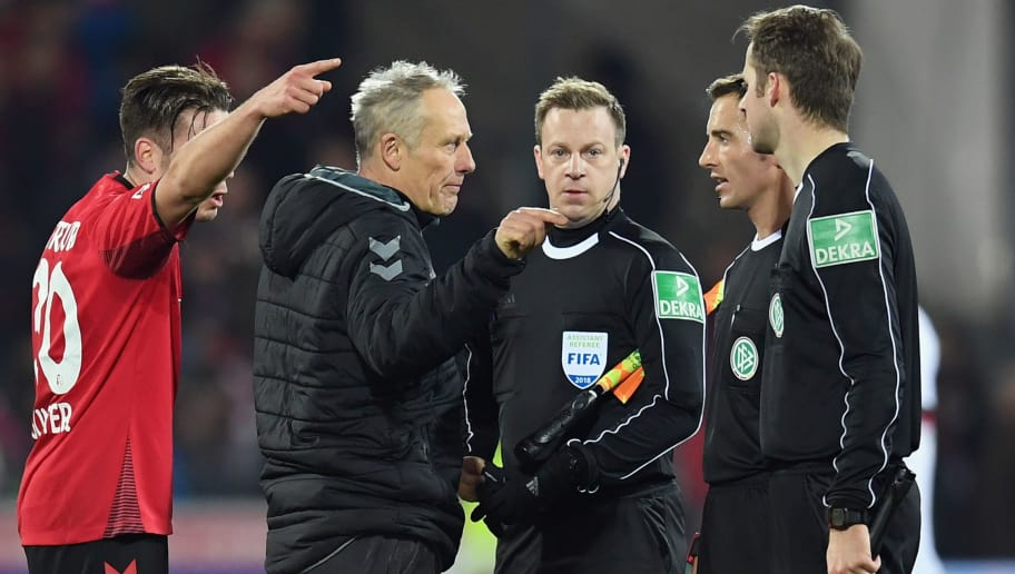 FREIBURG IM BREISGAU, GERMANY - MARCH 16: Head coach Christian Streich and Christian Guenter of Freiburg discuss with referee Sebastian Brand during the Bundesliga match between Sport-Club Freiburg and VfB Stuttgart at Schwarzwald-Stadion on March 16, 2018 in Freiburg im Breisgau, Germany.  (Photo by Matthias Hangst/Bongarts/Getty Images)