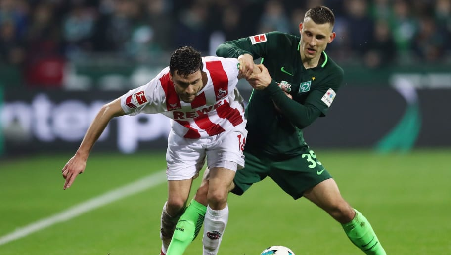 BREMEN, GERMANY - MARCH 12:  Jonas Hector (L) of Koeln is challenged by Maximilian Eggestein of Bremen during the Bundesliga match between SV Werder Bremen and 1. FC Koeln at Weserstadion on March 12, 2018 in Bremen, Germany.  (Photo by Lars Baron/Bongarts/Getty Images)