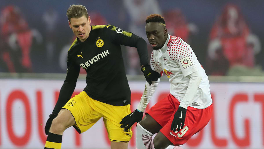 LEIPZIG, GERMANY - MARCH 03: Jean-Kevin Augustin of Leipzig (r) fights for the ball with Lukasz Piszczek of Dortmund during the Bundesliga match between RB Leipzig and Borussia Dortmund at Red Bull Arena on March 3, 2018 in Leipzig, Germany. (Photo by Boris Streubel/Bongarts/Getty Images)