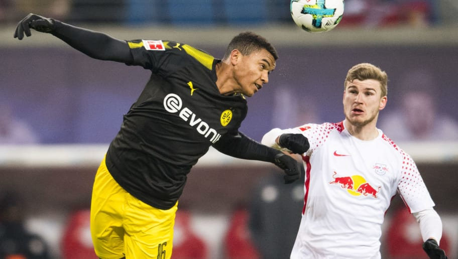 Leipzig´s forward Timo Werner (R) and Dortmund´s midfielder Swiss defender Manuel Akanji vie for the ball during the German first division Bundesliga football match RB Leipzig vs Borussia Dortmund in Leipzig, eastern Germany, on March 3, 2018. / AFP PHOTO / ROBERT MICHAEL / RESTRICTIONS: DURING MATCH TIME: DFL RULES TO LIMIT THE ONLINE USAGE TO 15 PICTURES PER MATCH AND FORBID IMAGE SEQUENCES TO SIMULATE VIDEO. == RESTRICTED TO EDITORIAL USE == FOR FURTHER QUERIES PLEASE CONTACT DFL DIRECTLY AT + 49 69 650050         (Photo credit should read ROBERT MICHAEL/AFP/Getty Images)