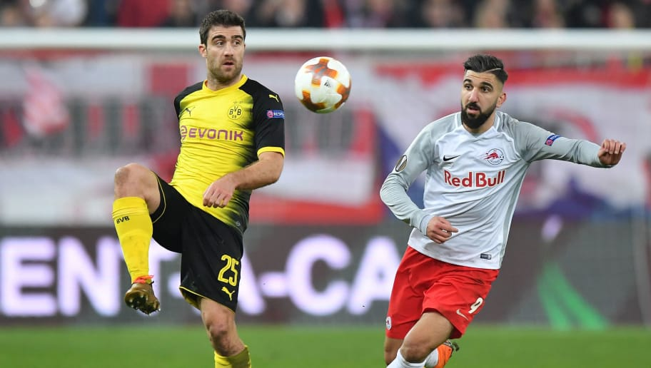 SALZBURG, AUSTRIA - MARCH 15: Sokratis Papastathopoulos of Dortmund and Munas Dabbur of Salzburg compete for the ball during the UEFA Europa League Round of 16, 2nd leg match between FC Red Bull Salzburg and Borussia Dortmund at the Red Bull Arena on March 15, 2018 in Salzburg, Austria. (Photo by Sebastian Widmann/Bongarts/Getty Images,)