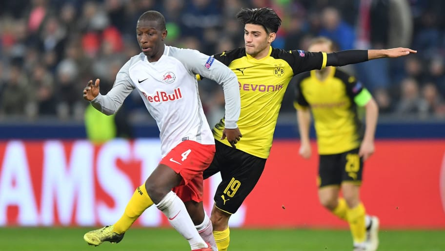 SALZBURG, AUSTRIA - MARCH 15: Amadou Haidara of Salzburg and Mahmoud Dahoud of Dortmund compete for the ball during the UEFA Europa League Round of 16, 2nd leg match between FC Red Bull Salzburg and Borussia Dortmund at the Red Bull Arena on March 15, 2018 in Salzburg, Austria. (Photo by Sebastian Widmann/Bongarts/Getty Images,)