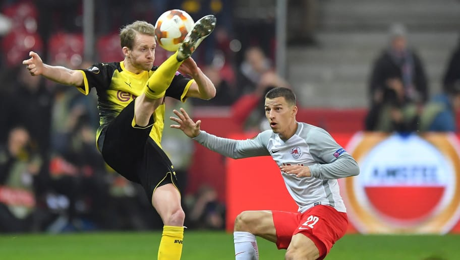 SALZBURG, AUSTRIA - MARCH 15: Andre Schuerrle of Dortmund and Stefan Lainer of Salzburg compete for the ball during the UEFA Europa League Round of 16, 2nd leg match between FC Red Bull Salzburg and Borussia Dortmund at the Red Bull Arena on March 15, 2018 in Salzburg, Austria. (Photo by Sebastian Widmann/Bongarts/Getty Images,)