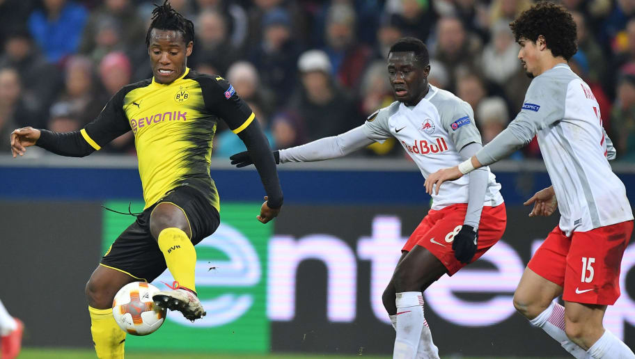 SALZBURG, AUSTRIA - MARCH 15: Michy Batshuayi of Dortmund plays the ball in front of Diadie Samassekou and Andre Ramalho of Salzburg during the UEFA Europa League Round of 16, 2nd leg match between FC Red Bull Salzburg and Borussia Dortmund at the Red Bull Arena on March 15, 2018 in Salzburg, Austria. (Photo by Sebastian Widmann/Bongarts/Getty Images,)