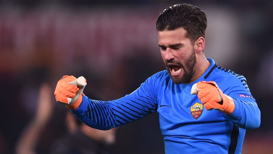 Roma's Brazilian goalkeeper Alisson celebrates afer winning 1-0 the UEFA Champions League round of 16 second leg football match AS Roma vs Shakhtar Donetsk on March 13, 2018 at the Olympic stadium in Rome.  Roma reached the Champions League quarter-finals for the first time in 10 years as Edin Dzeko edged them past Shakhtar Donetsk 1-0 at the Stadio Olimpico on Tuesday for an away goals victory. / AFP PHOTO / Filippo MONTEFORTE        (Photo credit should read FILIPPO MONTEFORTE/AFP/Getty Images)