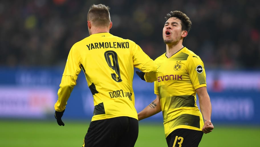 Dortmund's Ukrainian forward Andriy Yarmolenko and Dortmund's Portuges defender Raphael Guerreiro celebrate during the German First division Bundesliga football match Bayer Leverkusen vs Borussia Dortmund on December 2, 2017 in Leverkusen, western Germany. / AFP PHOTO / PATRIK STOLLARZ / RESTRICTIONS: DURING MATCH TIME: DFL RULES TO LIMIT THE ONLINE USAGE TO 15 PICTURES PER MATCH AND FORBID IMAGE SEQUENCES TO SIMULATE VIDEO. == RESTRICTED TO EDITORIAL USE == FOR FURTHER QUERIES PLEASE CONTACT DFL DIRECTLY AT + 49 69 650050         (Photo credit should read PATRIK STOLLARZ/AFP/Getty Images)