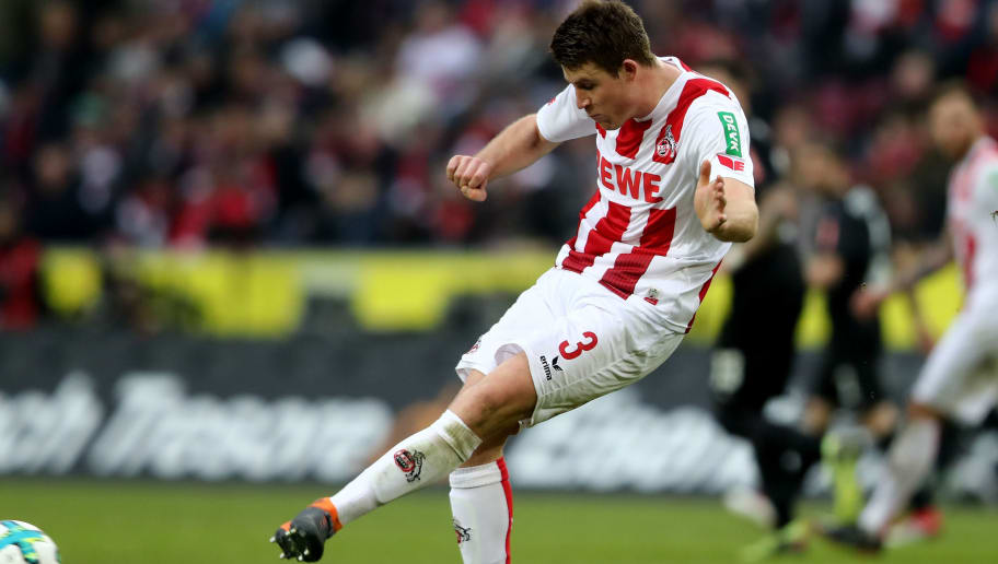 COLOGNE, GERMANY - MARCH 04: Dominique Heintz of Koeln runs with the ball during the Bundesliga match between 1. FC Koeln and VfB Stuttgart at RheinEnergieStadion on March 4, 2018 in Cologne, Germany. The match between Koeln and Stuttgart ended 2-3. (Photo by Christof Koepsel/Bongarts/Getty Images)