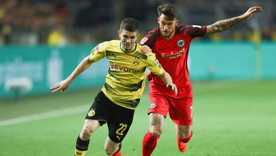 DORTMUND, GERMANY - MARCH 11: Christian Pulisic (L) of Dortmund is challenged by Danny Blum of Frankfurt during the Bundesliga match between Borussia Dortmund and Eintracht Frankfurt at Signal Iduna Park on March 11, 2018 in Dortmund, Germany.  (Photo by Lars Baron/Bongarts/Getty Images)