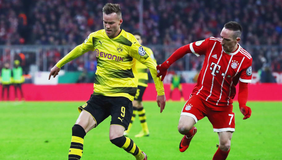 MUNICH, GERMANY - DECEMBER 20: Andrey Yarmolenko of Borussia Dortmund is challenged by Franck Ribery of Bayern Muenchen during the DFB Cup match between Bayern Muenchen and Borussia Dortmund at Allianz Arena on December 20, 2017 in Munich, Germany.  (Photo by Alexander Hassenstein/Bongarts/Getty Images)