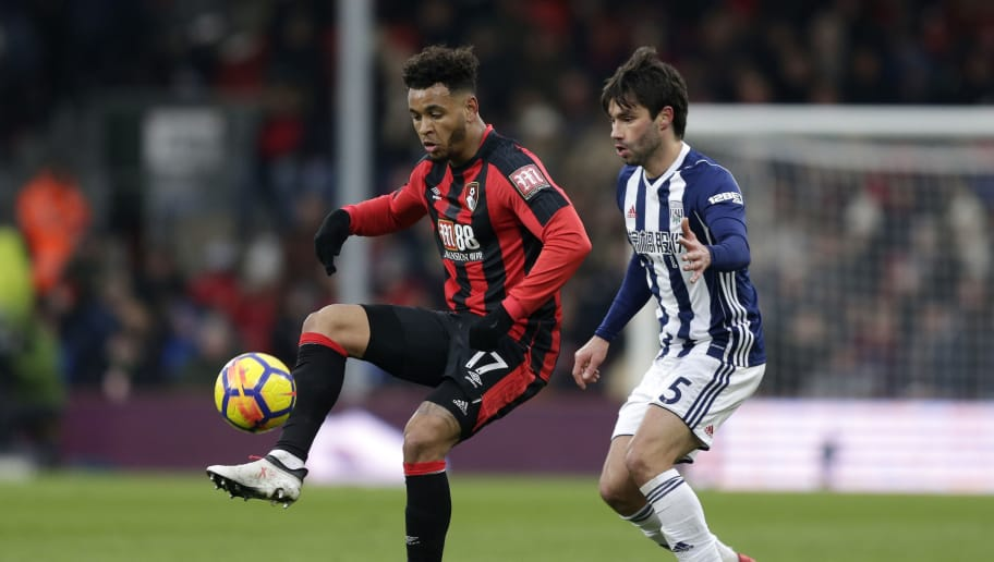 BOURNEMOUTH, ENGLAND - MARCH 17:  Joshua King of AFC Bournemouth and Claudio Yacob of West Bromwich Albion battle for the ball during the Premier League match between AFC Bournemouth and West Bromwich Albion at Vitality Stadium on March 17, 2018 in Bournemouth, England.  (Photo by Henry Browne/Getty Images)