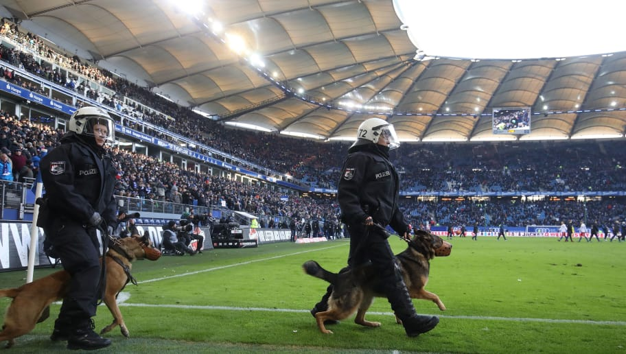 HAMBURG, GERMANY - MARCH 17:  Police walks on the pitch after the Bundesliga match between Hamburger SV and Hertha BSC at Volksparkstadion on March 17, 2018 in Hamburg, Germany.  (Photo by Oliver Hardt/Bongarts/Getty Images)