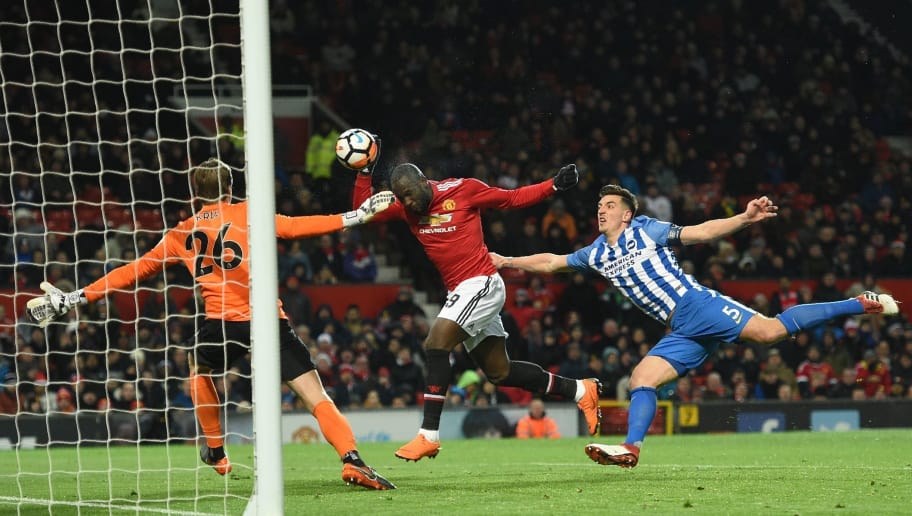 Manchester United's Belgian striker Romelu Lukaku (C) scores the team's first goal during the English FA Cup quarter-final football match between Manchester United and Brighton and Hove Albion at Old Trafford in Manchester, north west England, on March 17, 2018. / AFP PHOTO / Oli SCARFF / RESTRICTED TO EDITORIAL USE. No use with unauthorized audio, video, data, fixture lists, club/league logos or 'live' services. Online in-match use limited to 75 images, no video emulation. No use in betting, games or single club/league/player publications.  /         (Photo credit should read OLI SCARFF/AFP/Getty Images)