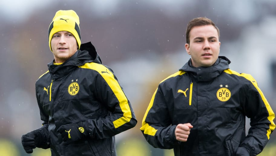 DORTMUND, GERMANY - NOVEMBER 21: Marco Reus (L-R) and Mario Goetze of Dortmund warm up during a training session ahead of their Champions League match against Legia Warszawa at Dortmund Brackel Training Ground on at Signal Iduna Park on November 21, 2016 in Dortmund, Germany. (Photo by Lukas Schulze/Bongarts/Getty Images)