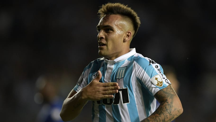 Argentina's Racing Club forward Lautaro Martinez celebrates after scoring his hat-trick against Brazil's Cruzeiro during the Copa Libertadores 2018 Group E first leg football at Juan Domingo Peron stadium in Buenos Aires, Argentina, on February 27, 2018.  Racing won by 4-2. / AFP PHOTO / JUAN MABROMATA        (Photo credit should read JUAN MABROMATA/AFP/Getty Images)