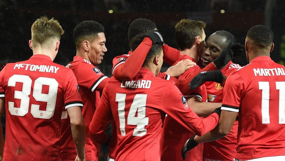 Manchester United's Serbian midfielder Nemanja Matic celebrates scoring the team's second goal, with teammates during the English FA Cup quarter-final football match between Manchester United and Brighton and Hove Albion at Old Trafford in Manchester, north west England, on March 17, 2018. / AFP PHOTO / Oli SCARFF / RESTRICTED TO EDITORIAL USE. No use with unauthorized audio, video, data, fixture lists, club/league logos or 'live' services. Online in-match use limited to 75 images, no video emulation. No use in betting, games or single club/league/player publications.  /         (Photo credit should read OLI SCARFF/AFP/Getty Images)
