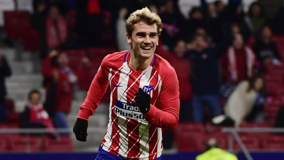 Atletico Madrid's French forward Antoine Griezmann celebrates his third goal during the Spanish league football match Club Atletico de Madrid against Club Deportivo Leganes SAD at the Wanda Metropolitano stadium in Madrid on February 28, 2018. / AFP PHOTO / PIERRE-PHILIPPE MARCOU        (Photo credit should read PIERRE-PHILIPPE MARCOU/AFP/Getty Images)