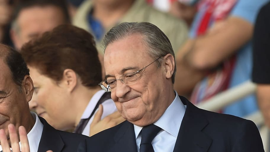President of Real Madrid Florentino Perez waves from the stands during the Spanish league football match Girona FC vs Real Madrid CF at the Montilivi stadium in Girona on October 29, 2017. / AFP PHOTO / Josep LAGO        (Photo credit should read JOSEP LAGO/AFP/Getty Images)