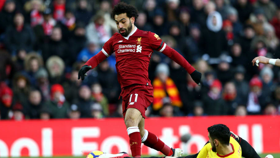 LIVERPOOL, ENGLAND - MARCH 17:  Mohamed Salah of Liverpool goes past Miguel Britos of Watford to score his side's first goal during the Premier League match between Liverpool and Watford at Anfield on March 17, 2018 in Liverpool, England.  (Photo by Jan Kruger/Getty Images)