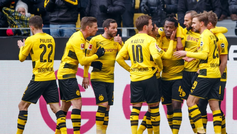 DORTMUND, GERMANY - MARCH 18:  Michy Batshuayi of Dortmund celebrates with team mates after scoring his teams first goal during the Bundesliga match between Borussia Dortmund and Hannover 96 at Signal Iduna Park on March 18, 2018 in Dortmund, Germany.  (Photo by Lars Baron/Bongarts/Getty Images)