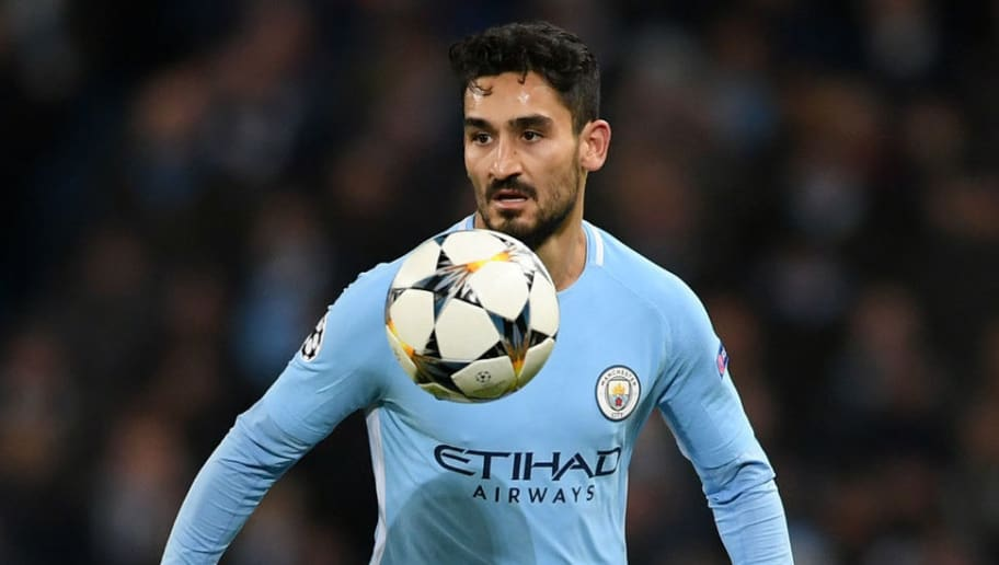 MANCHESTER, ENGLAND - MARCH 07:  Ilkay Gundogan of Manchester City runs with the ball during the UEFA Champions League Round of 16 Second Leg match between Manchester City and FC Basel at Etihad Stadium on March 7, 2018 in Manchester, United Kingdom.  (Photo by Laurence Griffiths/Getty Images)