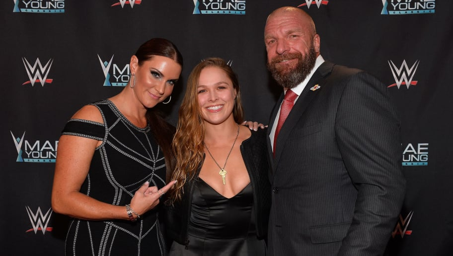 LAS VEGAS, NV - SEPTEMBER 12:  (L-R) WWE Chief Brand Officer Stephanie McMahon, MMA fighter Ronda Rousey and WWE Executive Vice President of Talent, Live Events and Creative Paul 'Triple H' Levesque appear on the red carpet of the WWE Mae Young Classic on September 12, 2017 in Las Vegas, Nevada.  (Photo by Bryan Steffy/Getty Images for WWE)