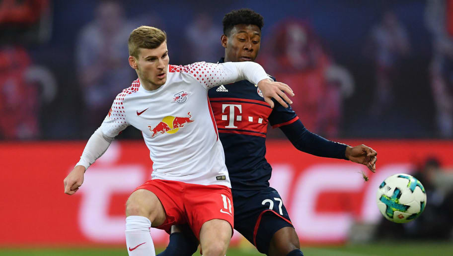 LEIPZIG, GERMANY - MARCH 18:  David Alaba of Bayern is challenged by Timo Werner of Leipzig during the Bundesliga match between RB Leipzig and FC Bayern Muenchen at Red Bull Arena on March 18, 2018 in Leipzig, Germany.  (Photo by Stuart Franklin/Bongarts/Getty Images)