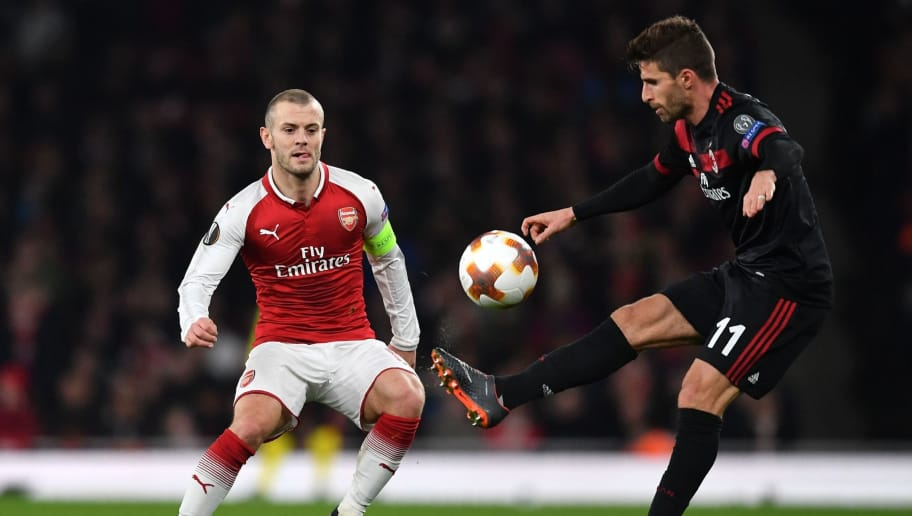 Arsenal's English midfielder Jack Wilshere (L) vies with AC Milan's Italian striker Fabio Borini during the UEFA Europa League round of 16 second-leg football match  between Arsenal and AC Milan at the Emirates Stadium in London on March 15, 2018.  / AFP PHOTO / Ben STANSALL        (Photo credit should read BEN STANSALL/AFP/Getty Images)