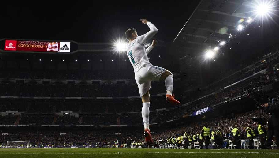 MADRID, SPAIN - MARCH 18: Cristiano Ronaldo of Real Madrid CF celebrates scoring their second goal during the La Liga match between Real Madrid CF and Girona FC at Estadio Santiago Bernabeu on March 18, 2018 in Madrid, Spain. (Photo by Gonzalo Arroyo Moreno/Getty Images)