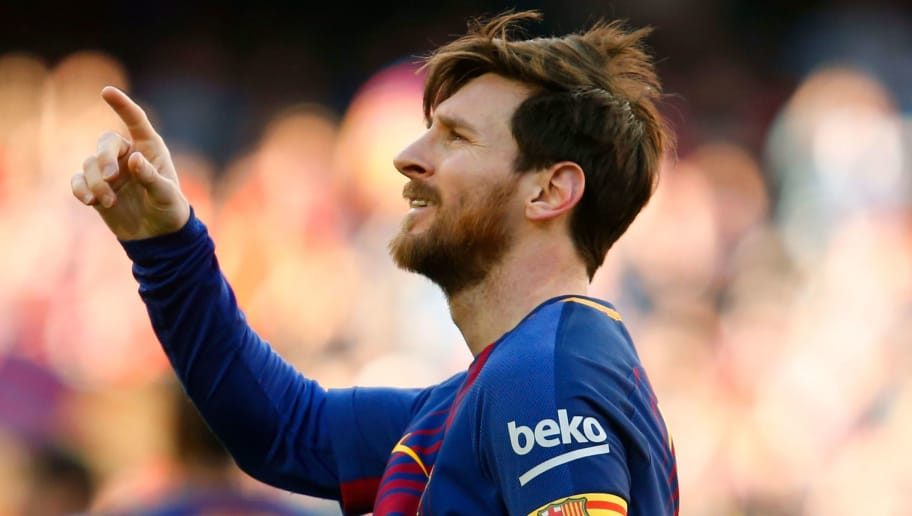 Barcelona's Argentinian forward Lionel Messi celebrates after scoring during the Spanish League football match between FC Barcelona and Athletic Club Bilbao at the Camp Nou stadium in Barcelona on March 18, 2018. / AFP PHOTO / Pau Barrena        (Photo credit should read PAU BARRENA/AFP/Getty Images)