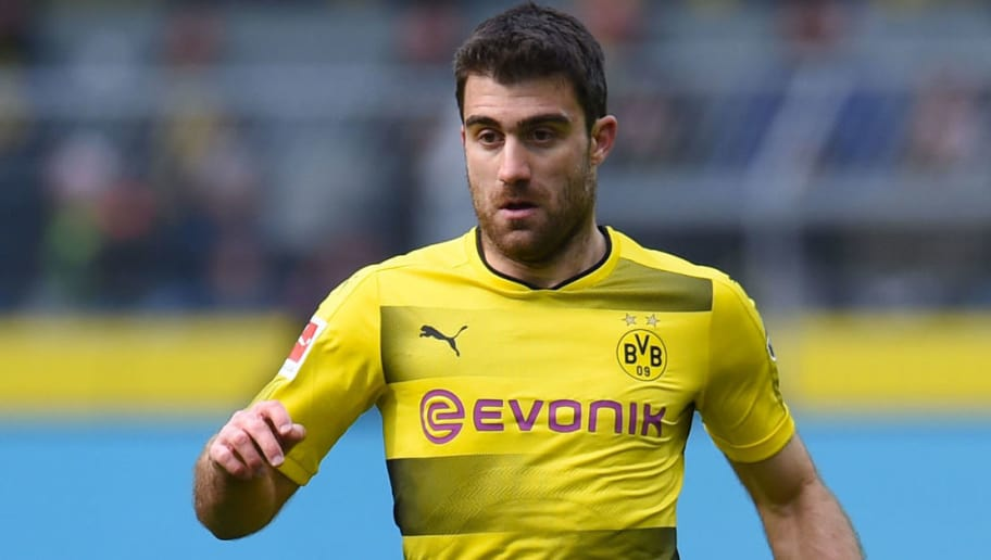 Dortmund's Greek defender Sokratis plays the ball during the German first division Bundesliga football match Borussia Dortmund vs Hanover 96, in Dortmund, western Germany, on March 18, 2018. / AFP PHOTO / Patrik STOLLARZ / RESTRICTIONS: DURING MATCH TIME: DFL RULES TO LIMIT THE ONLINE USAGE TO 15 PICTURES PER MATCH AND FORBID IMAGE SEQUENCES TO SIMULATE VIDEO. == RESTRICTED TO EDITORIAL USE == FOR FURTHER QUERIES PLEASE CONTACT DFL DIRECTLY AT + 49 69 650050         (Photo credit should read PATRIK STOLLARZ/AFP/Getty Images)