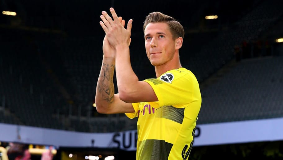 DORTMUND, GERMANY - AUGUST 04:  Erik Durm welcomes the fans during the Borussia Dortmund Season Opening 2017/18 at Signal Iduna Park on August 4, 2017 in Dortmund, Germany.  (Photo by Christof Koepsel/Bongarts/Getty Images)