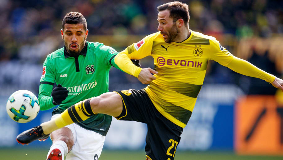 DORTMUND, GERMANY - MARCH 18:  during the Bundesliga match between Jonathas of Hannover is challenged by Gonzalo Castro of Dortmund Borussia Dortmund and Hannover 96 at Signal Iduna Park on March 18, 2018 in Dortmund, Germany.  (Photo by Lars Baron/Bongarts/Getty Images)