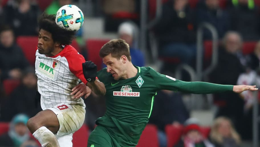 AUGSBURG, GERMANY - MARCH 17: Caiuby of Augsburg (l) fights for the ball with Sebastian Langkamp of Berlin during the Bundesliga match between FC Augsburg and SV Werder Bremen at WWK-Arena on March 17, 2018 in Augsburg, Germany. (Photo by Alex Grimm/Bongarts/Getty Images)