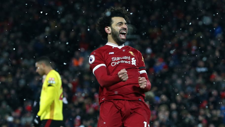 LIVERPOOL, ENGLAND - MARCH 17:  Mohamed Salah of Liverpool celebrates scoring his side's fourth goal during the Premier League match between Liverpool and Watford at Anfield on March 17, 2018 in Liverpool, England.  (Photo by Jan Kruger/Getty Images)