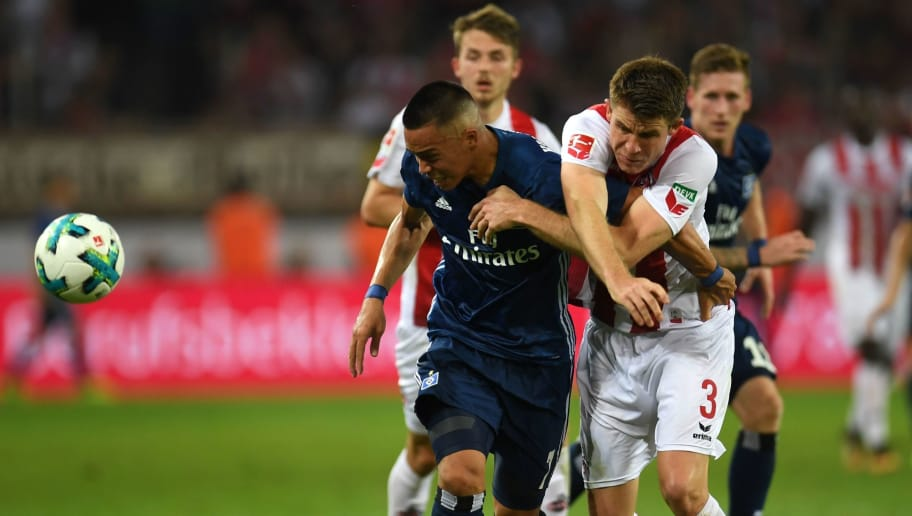 Cologne's defender Dominique Heintz and Hamburg's US striker Bobby Wood vie for the ball during the German First division Bundesliga football match 1.FC Cologne vs Hamburger SV in Cologne, western Germany, on August 25, 2017. / AFP PHOTO / PATRIK STOLLARZ        (Photo credit should read PATRIK STOLLARZ/AFP/Getty Images)