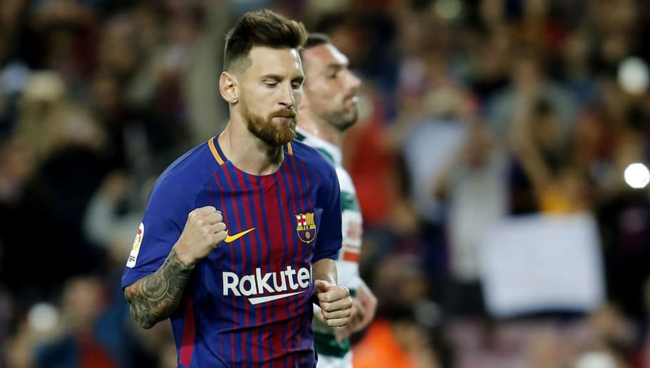 TOPSHOT - Barcelona's forward from Argentina Lionel Messi celebrates after scoring  during the Spanish league football match FC Barcelona against SD Eibar at the Camp Nou stadium in Barcelona on September 19, 2017. / AFP PHOTO / PAU BARRENA        (Photo credit should read PAU BARRENA/AFP/Getty Images)