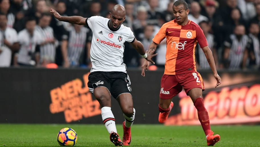 Besiktas' Dutch midfielder Ryan Babel (L) vies for the ball with Galatasaray's Mariano during the Turkish Super Lig football match between Besiktas and Galatasaray on December 2, 2017 at Vodafone Park Stadium in Istanbul. / AFP PHOTO / OZAN KOSE        (Photo credit should read OZAN KOSE/AFP/Getty Images)