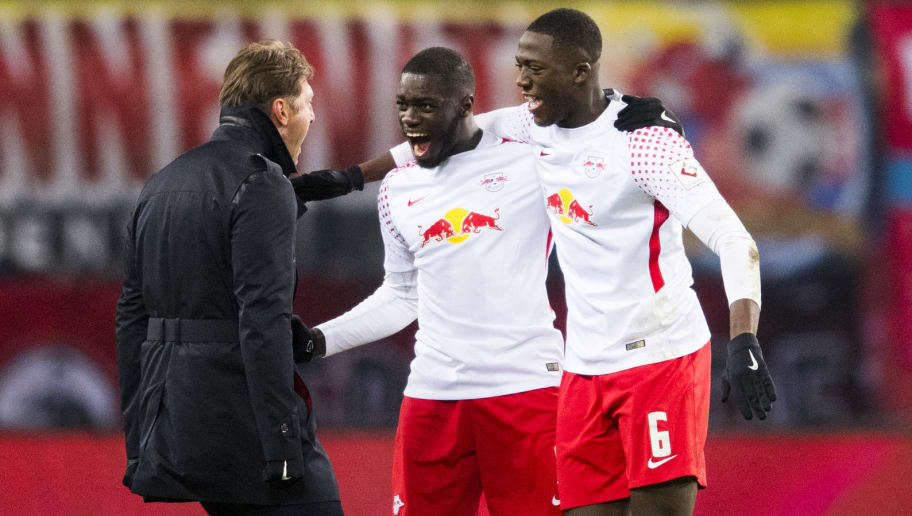 Leipzig's Austrian head coach Ralph Hasenhuettl (L), Leipzig's French defender Dayot Upamecano  (C) and Leipzig's French defender Ibrahima Konate celebrate after winning the German first division Bundesliga football match between RB Leipzig and FC Bayern Munich in Leipzig, eastern Germany on March 18, 2018.  / AFP PHOTO / ROBERT MICHAEL / RESTRICTIONS: DURING MATCH TIME: DFL RULES TO LIMIT THE ONLINE USAGE TO 15 PICTURES PER MATCH AND FORBID IMAGE SEQUENCES TO SIMULATE VIDEO. == RESTRICTED TO EDITORIAL USE == FOR FURTHER QUERIES PLEASE CONTACT DFL DIRECTLY AT + 49 69 650050  / RESTRICTIONS: DURING MATCH TIME: DFL RULES TO LIMIT THE ONLINE USAGE TO 15 PICTURES PER MATCH AND FORBID IMAGE SEQUENCES TO SIMULATE VIDEO. == RESTRICTED TO EDITORIAL USE == FOR FURTHER QUERIES PLEASE CONTACT DFL DIRECTLY AT + 49 69 650050        (Photo credit should read ROBERT MICHAEL/AFP/Getty Images)