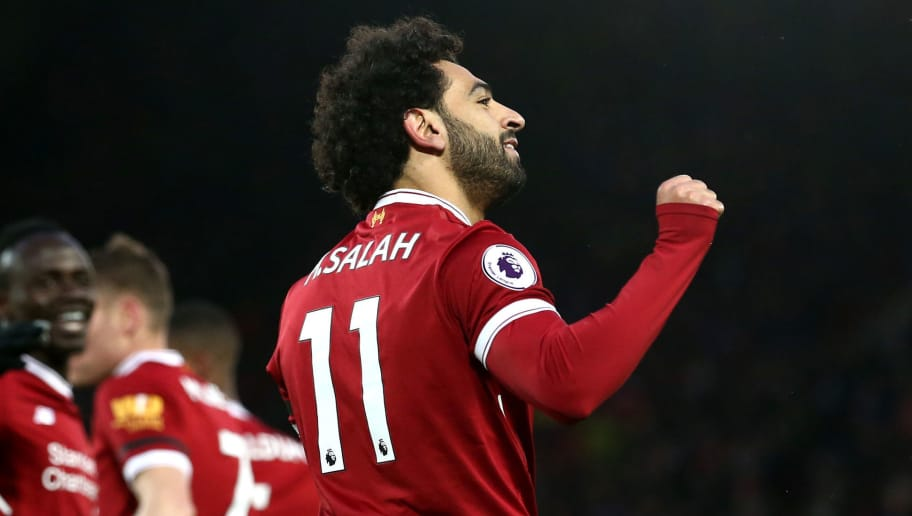 LIVERPOOL, ENGLAND - MARCH 17:  Mohamed Salah of Liverpool celebrates scoring his side's second goal during the Premier League match between Liverpool and Watford at Anfield on March 17, 2018 in Liverpool, England.  (Photo by Jan Kruger/Getty Images)