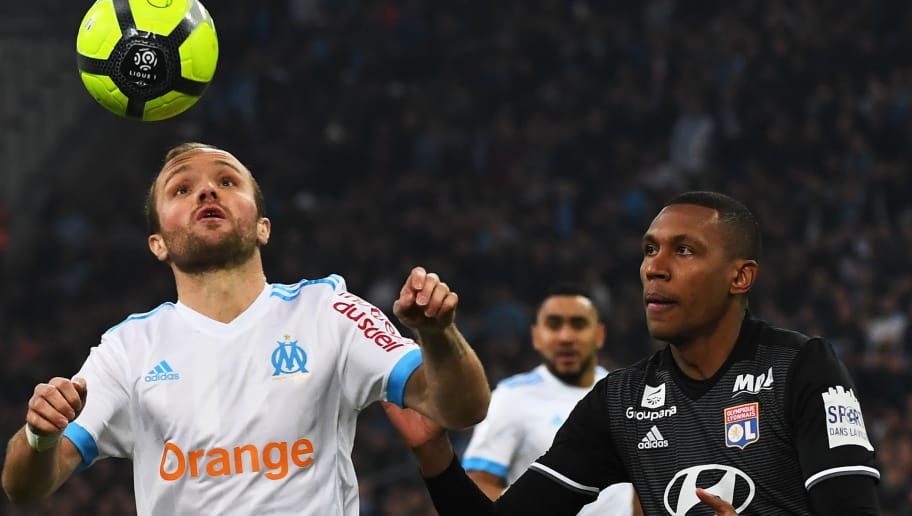 Olympique de Marseille's French forward Valere Germain (L) vies with Lyon's Brazilian defender Marcelo  (L) during the French L1 football match Marseille (OM) vs Lyon (OL) on March 18, 2018 at the Velodrome stadium in Marseille, southern France. / AFP PHOTO / ANNE-CHRISTINE POUJOULAT        (Photo credit should read ANNE-CHRISTINE POUJOULAT/AFP/Getty Images)