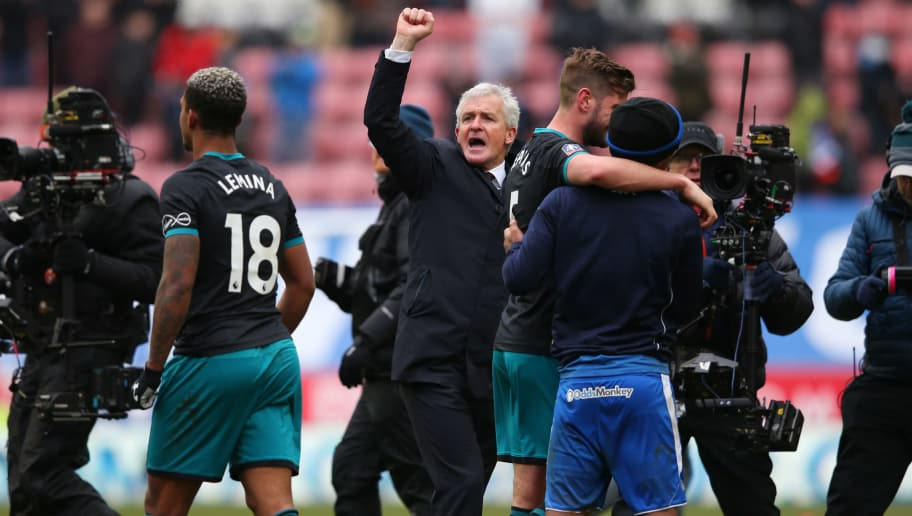 WIGAN, ENGLAND - MARCH 18:  Mark Hughes manager of Southampton (C) celebrates with players after victory in The Emirates FA Cup Quarter Final match between Wigan Athletic and Southampton at DW Stadium on March 18, 2018 in Wigan, England.  (Photo by Alex Livesey/Getty Images)